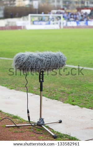 large microphone boom for tv at a football stadium