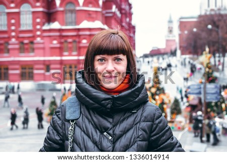 Young russian woman on a Red Square close to Kremlin. Moscow city. #1336014914