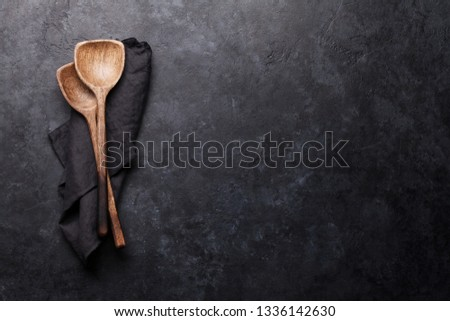 Cooking wooden utensils on stone kitchen table. Food cooking template concept. Top view with copy space. Flat lay #1336142630