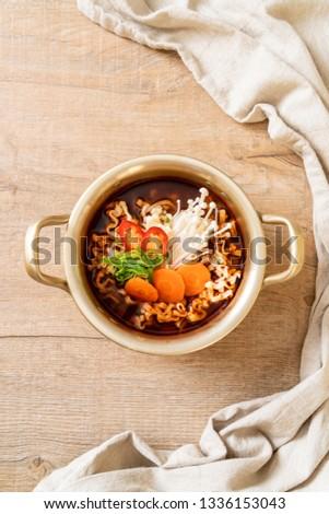 korean instant noodles in golden pot - korean food style #1336153043