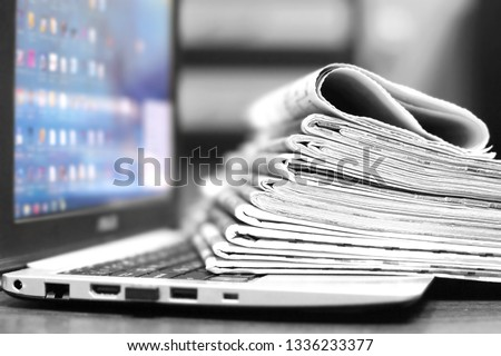 Newspapers and Laptop. Different Concepts for News -  Network or Traditional Tabloid Journals. Data Sources - Electronic Screen of Computer or Paper Pages of Magazines, Internet or Papers