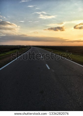 Sunset on the road #1336282076