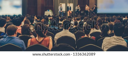 Banner of Abstract blurred photo of conference hall or seminar room with attendee background Royalty-Free Stock Photo #1336362089