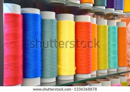Large colorful polypropylene thread set in rainbow mood. Multicolor bobbin thread. Polypropylene multifilament yarns. Set of sewing thread coils, miscellaneous colours. #1336368878