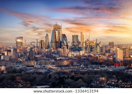 Sunrise over the urban skyline of the City of London, UK, financial district and hub of banking institutions #1336413194