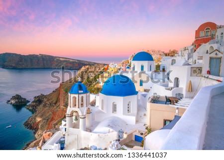 Great twilight view of Santorini island. Sunset on the famous Oia city, Greece, Europe #1336441037