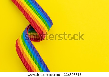 LGBT rainbow headband on solid yellow background with copy space using as celebrate of homosexual, lesbian, gay and transgender concept. #1336505813