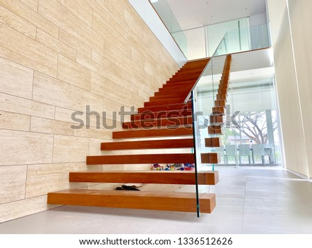 Wooden stairs and glass railing in modern houses,12/03/2019 Bangkok Thailand.Creating a home concept. #1336512626