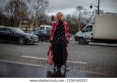 Paris, France - March 05 2019: Paris Fashion Week Street Style  Fall/Winter 2019/2020 Guest outside Chanel fashion Show #1336560293