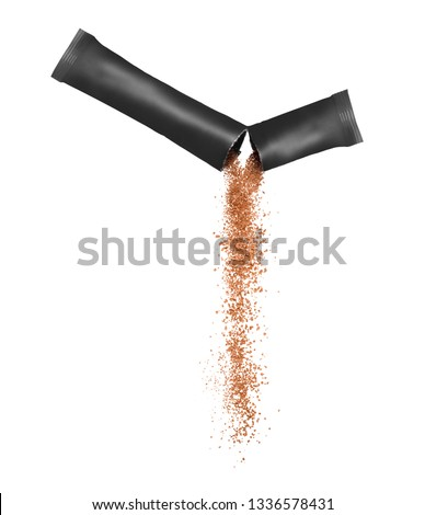 Freeze dried instant coffee pours from the packaging, isolated on a white background. #1336578431