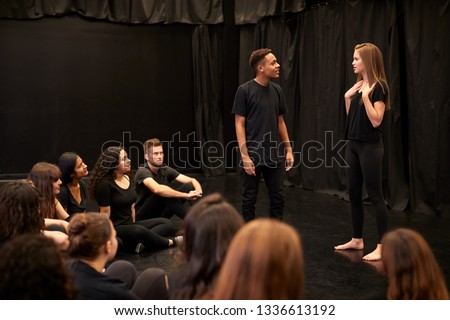 Male And Female Drama Students At Performing Arts School In Studio Improvisation Class Royalty-Free Stock Photo #1336613192