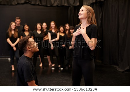 Male And Female Drama Students At Performing Arts School In Studio Improvisation Class Royalty-Free Stock Photo #1336613234