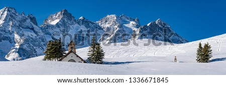 Col du Lautaret, Hautes-Alpes, Ecrins National Park, Alps, France: Panoramic winter view on the glaciers and mountain range of La Meije with La Chappelle des Fusillés