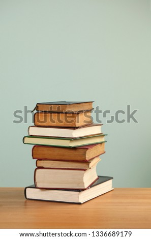 A stack of books on the table #1336689179