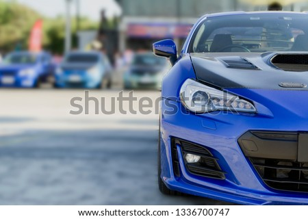 sports car and Used cars, parked in the parking lot of Dealership waiting to be sold and delivered to customers and waiting for the auction with the trading concept and auction in Automotive Industry Royalty-Free Stock Photo #1336700747