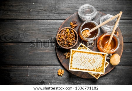 Assortment of different types of honey. On a wooden background. #1336791182