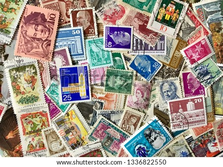 Various old postage stamps Royalty-Free Stock Photo #1336822550
