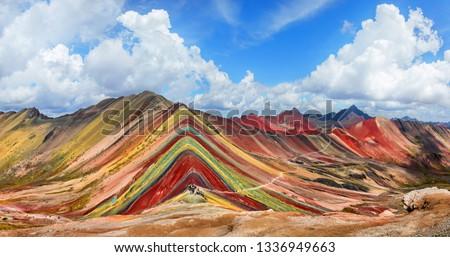 Unidentified  tourists walking on the Rainbow Mountain (Vinicunca Montana de Siete Colores - Spanish) in Cusco, Peru. #1336949663