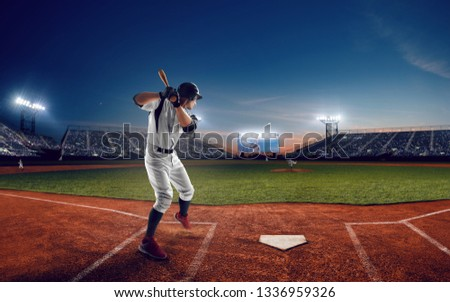 Baseball player at professional baseball stadium in evening during a game. #1336959326