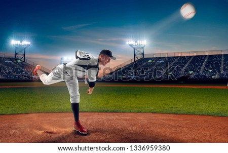 Baseball player at professional baseball stadium in evening during a game. #1336959380