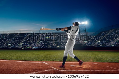 Baseball player at professional baseball stadium in evening during a game. #1336959422