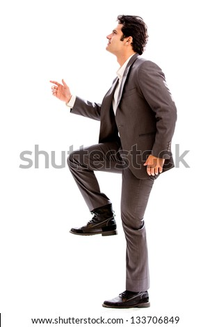 Business man stepping up - isolated over a white background #133706849