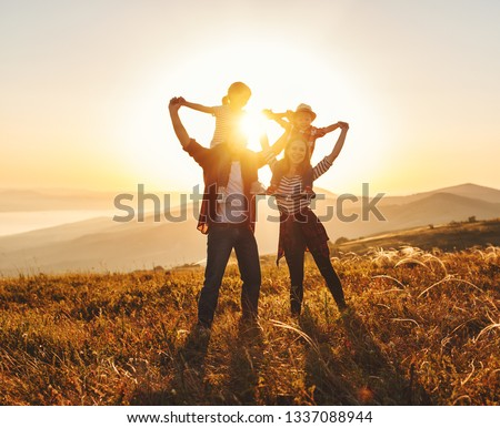 Happy family: mother, father, children son and  daughter on nature  on sunset #1337088944