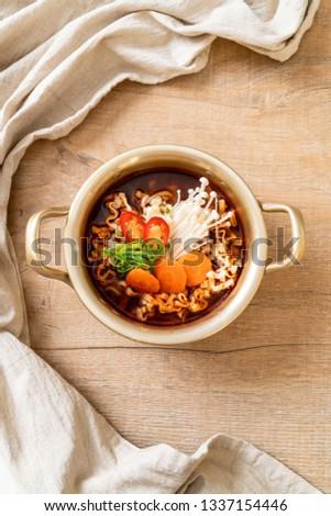 korean instant noodles in golden pot - korean food style #1337154446