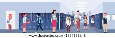 female teacher with mix race schoolchildren group in school lobby corridor interior with rows of blue lockers education concept horizontal banner full length flat #1337159648