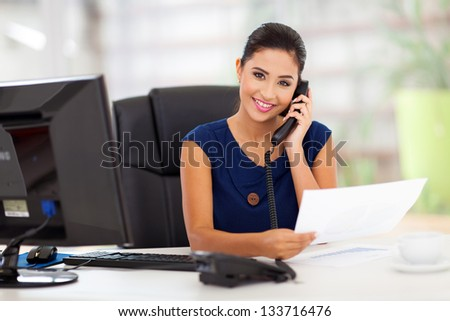portrait of young secretary answering telephone Royalty-Free Stock Photo #133716476