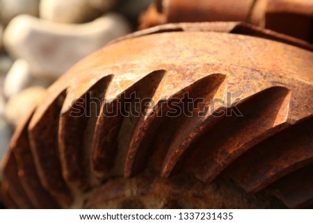 closeup rusty wheel, rusty flywheel, rusty rotor, rusty cogwheel #1337231435