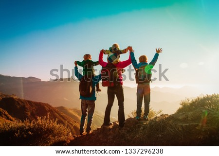 happy family travel in mountains at sunset #1337296238