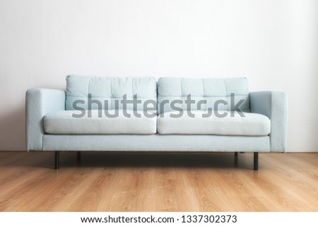 Blue sofa background at home #1337302373