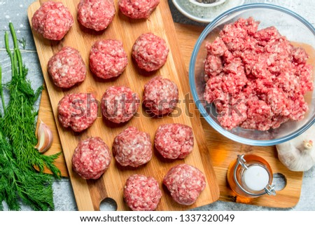 Raw beef meatballs with spices and fragrant dill . On a rustic background. #1337320049