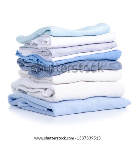 Stack blue white clothing sweater t-shirt on white background isolation #1337339513