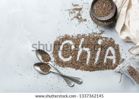 Healthy eating, dieting and nutrition, vegan concept. Organic chia seeds in a bowl, ingredient, superfood. Flat lay top view background #1337362145
