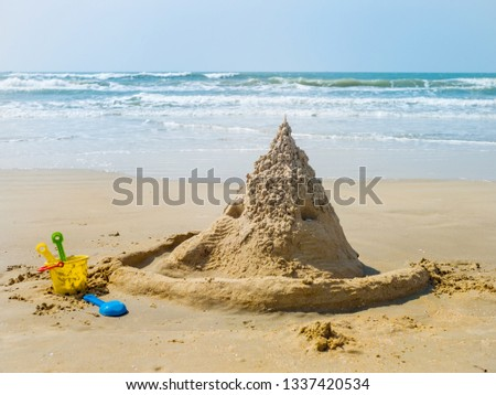 Sand castle by the sea close up #1337420534