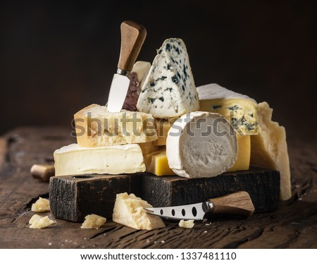 Assortment of different cheese types on wooden background. Cheese background. #1337481110