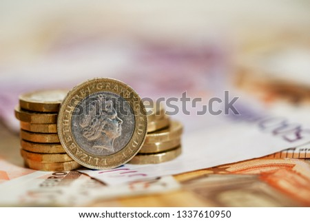 One pound sterling coin after Brexit small euro exchange rate #1337610950