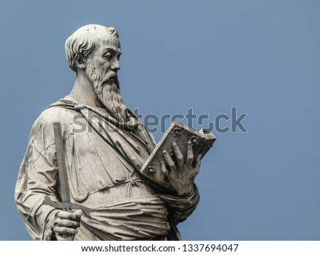 Statue of the apostle St. Paul holding a broken sword and a book with the pedestal inscription Borgo, on Ponte Sant'Angelo, Rome, Italy. The sculpture was by the Italian early Renaissance Paolo Romano #1337694047