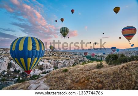 Cappadocia / Turkey - July 22 2018: Ballons in early morning time in Cappadocia/Kapadokya, Turkey                          #1337744786