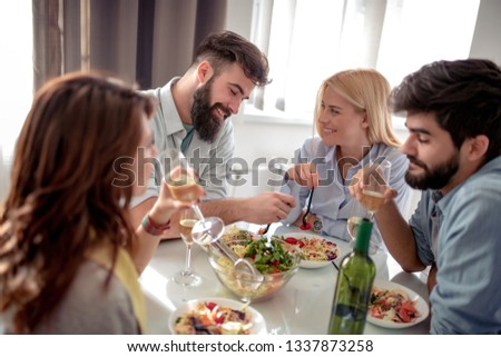 Friends meeting.Group of happy people have friendly conversation, laughing at party dinner. #1337873258
