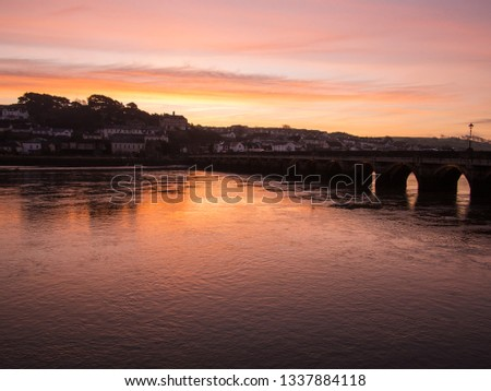 sunrise over Bideford`s ancient long bridge in Devon , England Royalty-Free Stock Photo #1337884118