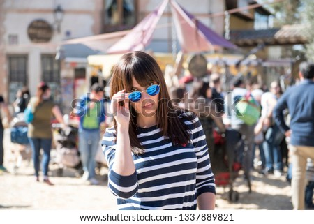 Pretty woman model and photographer posing at the Medieval Fair in the village of Chinchón, Madrid, Spain #1337889821