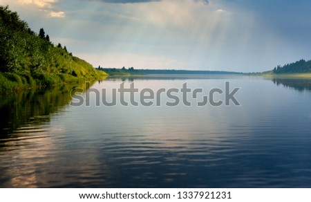 Pinega river, a tributary of the Northern Dvina river with beautiful banks in the evening sun. #1337921231