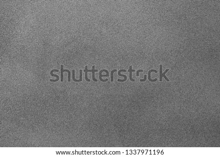 Gray classic texture for the designer background. Rough illuminated surface. Artistically textured background. Concrete wall with plaster. Space to fill. Raster monochrome image. #1337971196