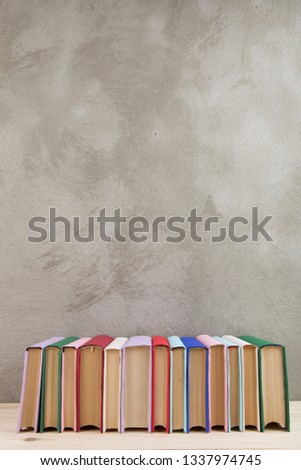 Education and reading concept - group of colorful books on the wooden table #1337974745