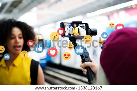 Vlogger streaming a live video live at a train platform #1338120167