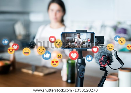 Food vlogger recording a video #1338120278