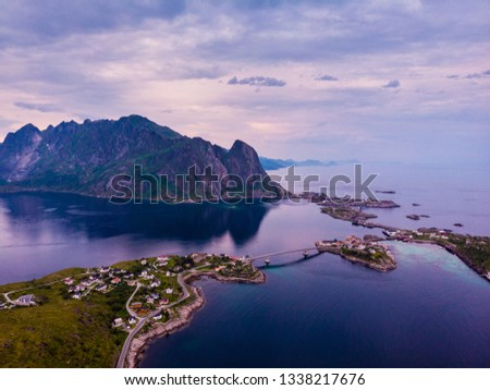 Scenic fjord landscape with Reine village, coast nature with sharp high mountain peaks, Lofoten islands North Norway. Travel destination. #1338217676
